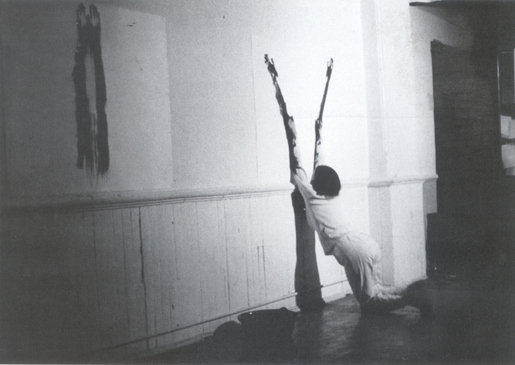 Ana Mendieta, Body Tracks (Rastros Corporales), 1982, photograph taken during a performance at Franklin Furnace, New York City