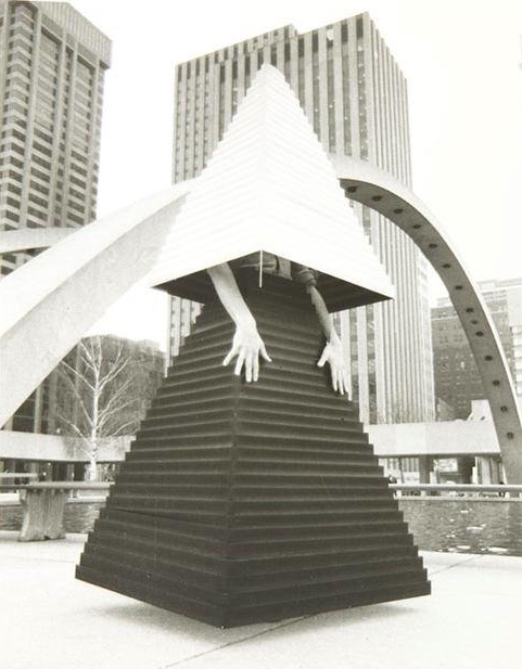 General Idea, Felix Partz models V.B. Gown #3 at City Hall, Toronto, 1975-1977. Gelatin silver print, 25.4 x 20.3 cm