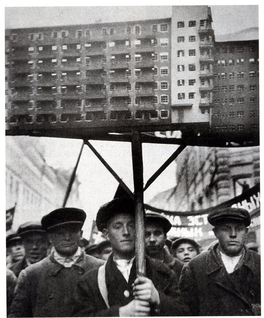 Soviet Workers with a model of planned housing c 1930