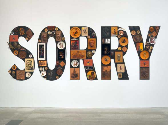 Tony Albert, Sorry, 2008, found kitsch objects applied to vinyl letters, 99 objects, 200 x 510 x 10 cm (installed)